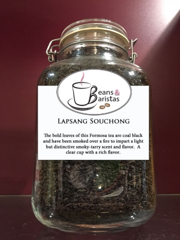 The bold leaves of this Formosa tea are coal black and have been smoked over a fire to impart a light but distinctive smoky-tarry scent and flavor.  A clear cup with a rich flavor.